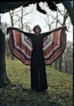 Sasha wearing her 'Kikan' cape that was originally designed for Browns in London